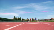 Track runners crossing finish line video