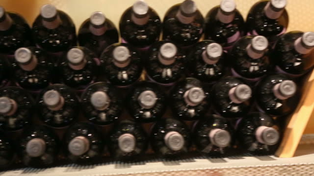 Tracking shot of bottles in cellar room video