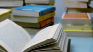 tracking shot of stacked books on a table video