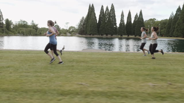 Tracking shot of women's jogging group video