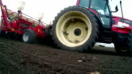 Tractor and seed drill in the field video