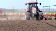 Tractor and Seeder Planting Crops video
