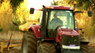 Tractor at work on farm land video