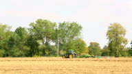 Tractor baling the straw video