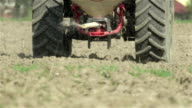 SLOW MOTION CLOSE U P: Tractor fertilizing the field with slurry video