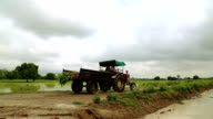 Tractor going through field video