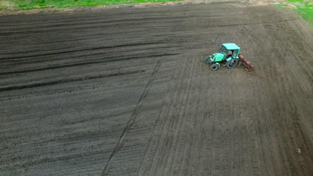 Tractor in a field making fertilizer video