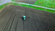 Tractor in a field making fertilizer video