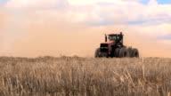 Tractor in wheat field stubble video