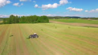 Tractor on field AERIAL video