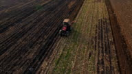 Tractor plong on a farm field video