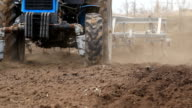 Tractor ploughing the field video