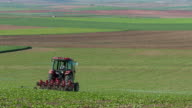 Tractor plowing a field video