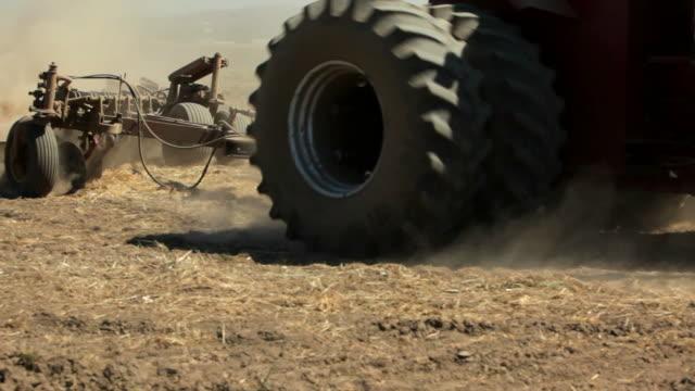 Tractor plowing field video