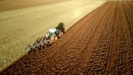 AERIAL : Tractor plowing Field video