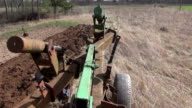 Tractor plowing meadow video