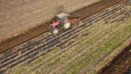 Tractor plowing on a field video