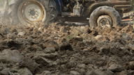 HD : tractor plowing the soil for cultivation video