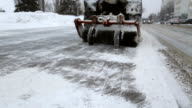 A tractor removes snow from the sidewalk video