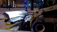 Tractor removing snow from city street video