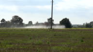 Tractor spray fertilize field with insecticide herbicide chemicals. video