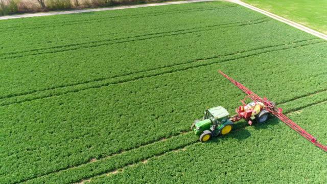 Tractor Spraying Crop Field In Spring video