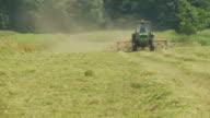 HD: Tractor Tedding Grass video
