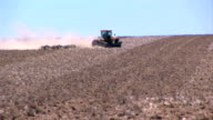 Tractor working the field video