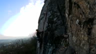 Trad climber climbs Granite crack stops and places protection video
