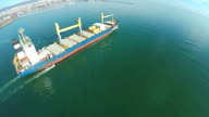 AERIAL, trade ship in the sea. Flying above ship ocean video