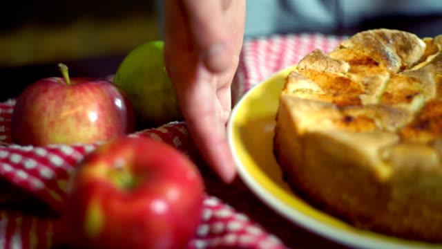 Traditional american apple pie on kitchen table. Closeup. Autumn dessert video