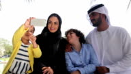 Traditional Arabian family taking selfie at nature video