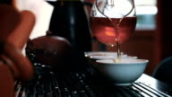 Traditional chinese tea ceremony on the tea table, close up, low key video