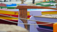 Traditional colorful small boat, close up on rope - Collioure Harbor - France in Europe. video