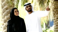 Traditional Emirati young couple outside - slowmotion video