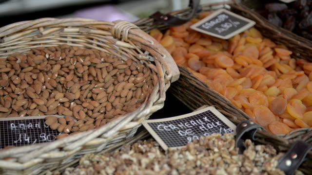 Traditional french dried fruits and nuts on a provencal market video