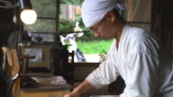 Traditional Japanese blacksmith grinding a blade video