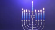 Traditional Jewish Menorah with candles lit video