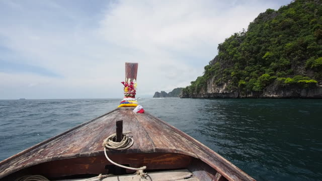Traditional Longtail Boat Traveling in the Waters of Koh Phi Phi, Thailand video