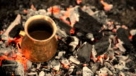 Traditional process boil Turkish coffee on coals. video