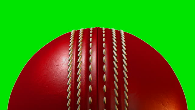 Traditional red cricket ball with a leather stitched surface rotating once video