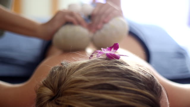 Traditional Thai herbal compress massage video