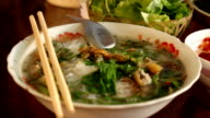 Traditional Vietnamese beef soup pho on a wooden background video