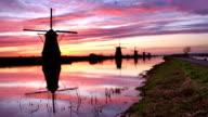Traditional windmills at sunrise, Kinderdijk, The Netherlands video