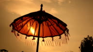 Traditions umbrella on the island of Bali, Sunset Indonesia video