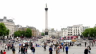 Trafalgar Square, London - time lapse of people and vehicles around it video