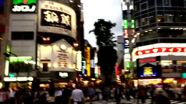 Traffic and People Crossing the Road in Shinjuku Japan video