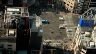 Traffic and people passing through busy intersection of Tokyo video