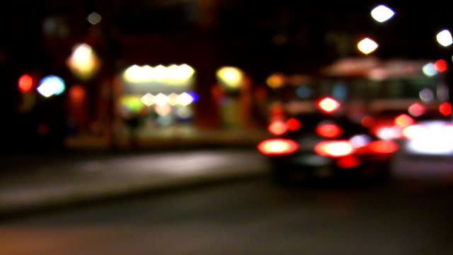 Traffic approaches intersection. Defocused lights. video