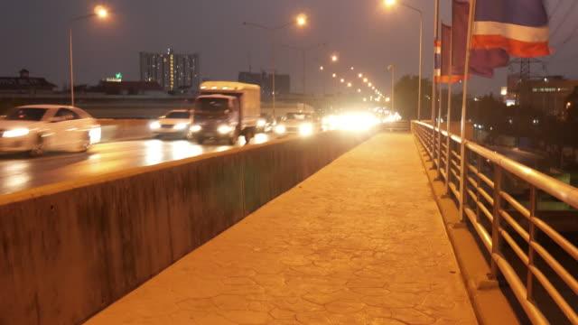 Traffic at night, on bridge, Bangkok, Thailand video